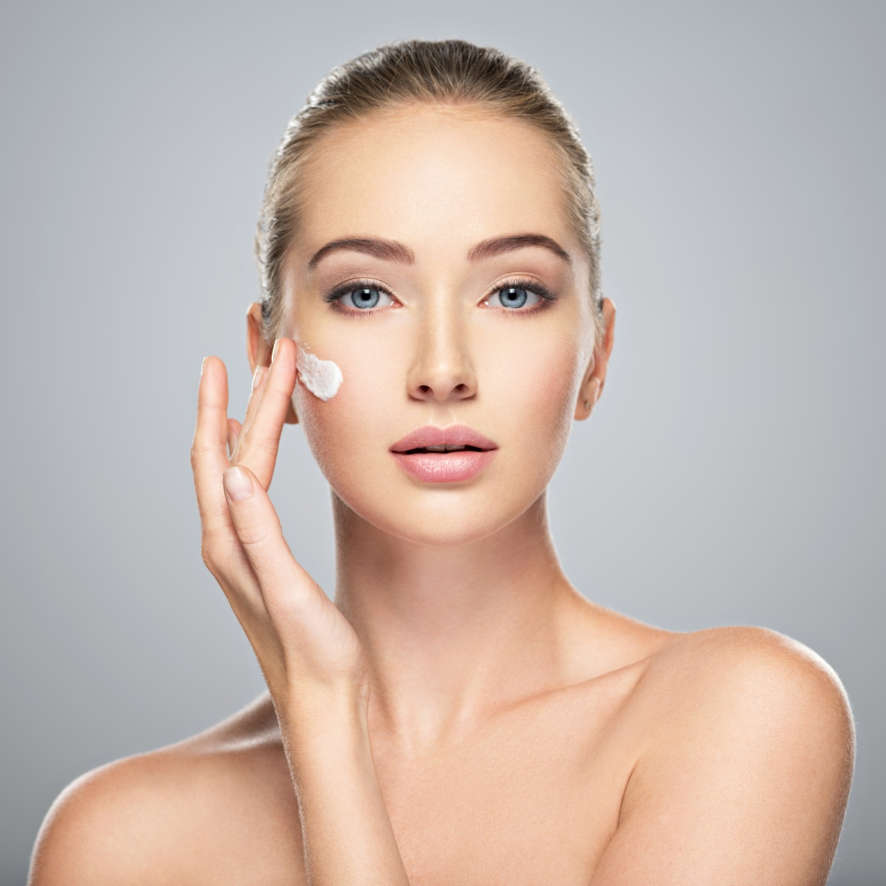 woman gets cream in the face. Skin care concept.